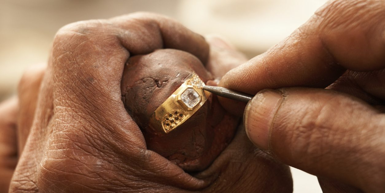 man working on old gold ring